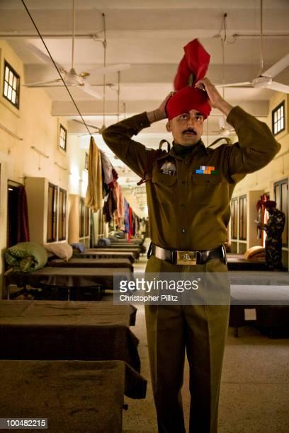 A Predidential Bodyguard (PBG) soldier dressing