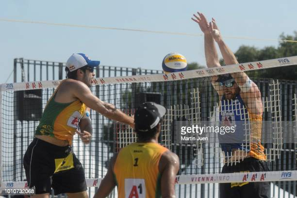 Predo Solberg Salgado of Brazil shoots the ball over the net during match im the men's round of 16 between Predo Solberg Salgado of Brazil and Bruno...