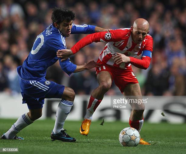 Predrag Djordjevic of Olympiakos takes on Paulo Ferreira of Chelsea during the UEFA Champions League first knockout round second leg match between...