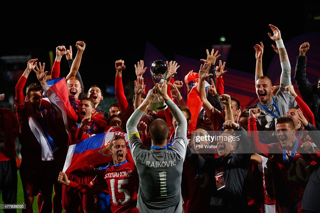 Predrag Rajkovic of Serbia holds up the trophy following the FIFA U-20 World Cup Final match between Brazil and Serbia at North Harbour Stadium on June 20, 2015 in Auckland, New Zealand.