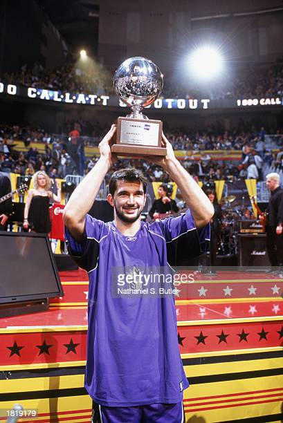 Predrag Stojakovic of the Sacramento Kings holds up his winning trophy in the 1800CallATT Shootout during AllStar Weekend at Philips Arena on...
