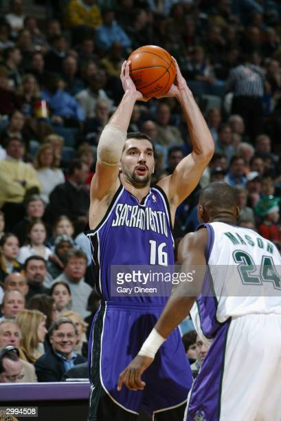 Predrag Stojakovic of the Sacramento Kings looks to pass over Desmond Mason of the Milwaukee Bucks during the game at the Bradley Center on February...