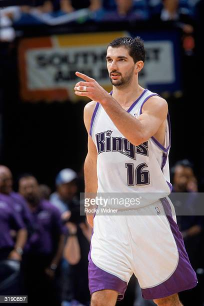 Predrag Stojakovic of the Sacramento Kings signals to his team during the NBA game against the Milwaukee Bucks at Arco Arena on March 23, 2004 in...