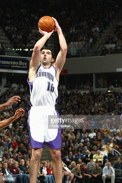 Predrag Stojakovic of the Sacramento Kings takes the open jumper against the Utah Jazz during the game on February 27 2004 at Arco Arena in...