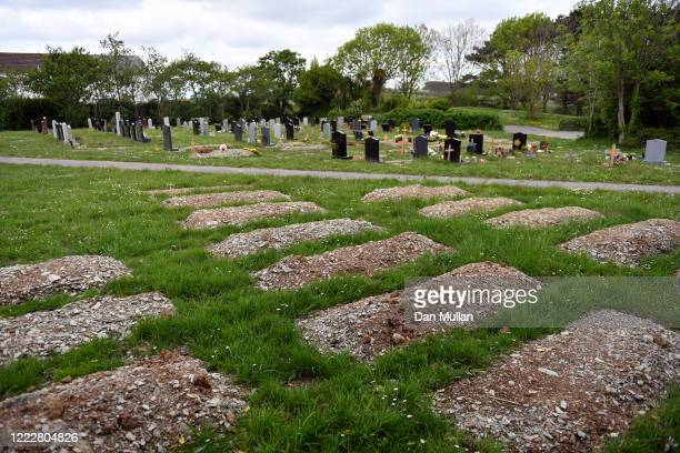 Pre-dug graves for Covid-19 deaths are seen in Fairpark Cemetery on May 04, 2020 in Newquay, England. The country continued quarantine measures...