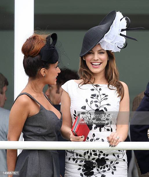 Preeya Kalidas and Kelly Brook watch ladies day at 'Glorious Goodwood' at Goodwood on August 2 2012 in Chichester England