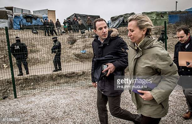 Prefect of the NordPasdeCalais region Fabienne Buccio arrives to deliver a press conference at the 'Jungle' migrant camp in Calais on February 21...