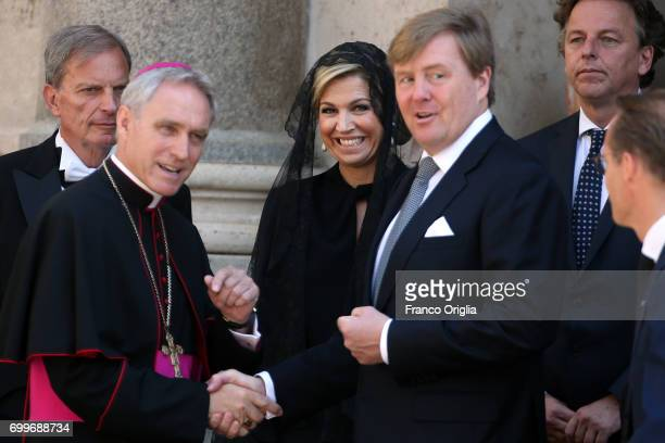 Prefect of the papal household Georg Gaenswein greets Dutch King WillemAlexander and Queen Maxima as they leave the Apostolic Palace at the end of an...