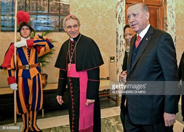 Prefect of the Papal Household Georg Gaenswein welcomes Turkey's President Recep Tayyip Erdogan to the Vatican prior to a private audience with Pope...