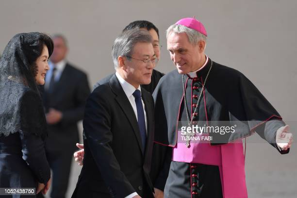 Prefect of the Papal Household Georg Ganswein greets South korean President Moon Jaein and his wife Kim Jungsook upon their arrival at the Vatican...