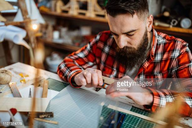 prefectionist in his hobby - model kit stock pictures, royalty-free photos & images