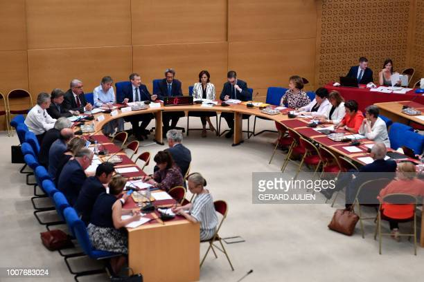 Prefet of HautsdeFrance region Michel Lalande and General Inspector director of the public security of the Nord region LucDider Mazoyer sit next to...