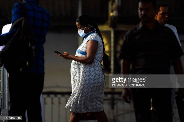 Preganant passenger wears a facemask at Fort railway station during a public holiday declared by the Sri Lankan government to avoid gatherings as a...