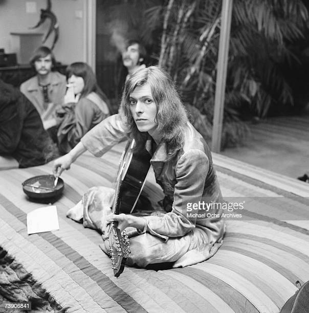 Pre-glam David Bowie jams at a party thrown by publicist and future nightclub impresario and DJ Rodney Bingenheimer at lawyer Paul Figen's house in...