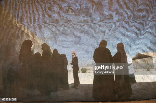 Pregnant and lactating women line up to register at a clinic run by JHAS and the United Nations Population Fund at the Zaatari refugee camp in Jordan...
