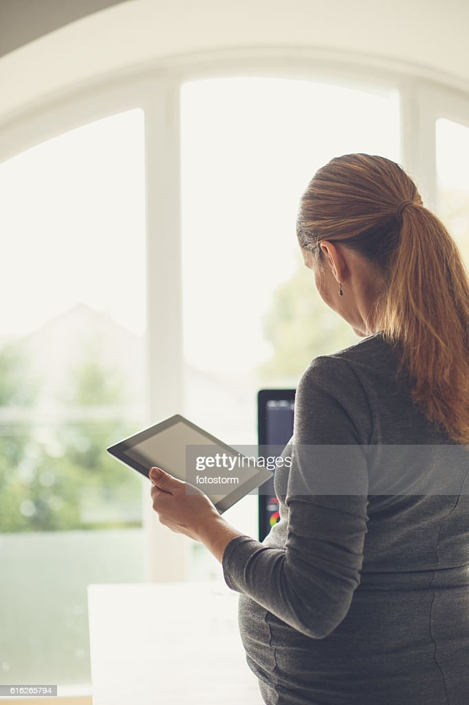 Pregnant and still working : Stock Photo