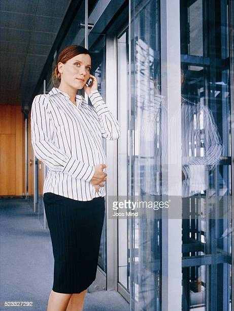 Pregnant Businesswoman Using Cell Phone
