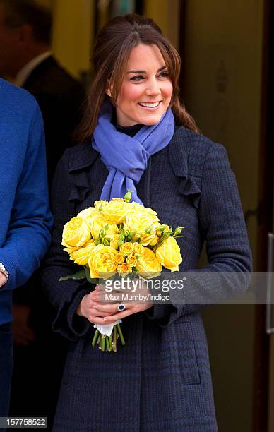 A pregnant Catherine Duchess of Cambridge accompanied by her husband Prince William Duke of Cambridge leaves the King Edward VII hospital where she...