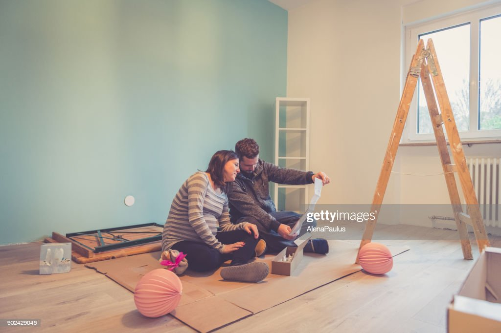 Pregnant couple in a new home : Stock Photo
