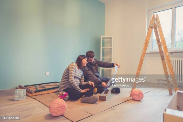 pregnant couple in a new home - reform stock pictures, royalty-free photos & images