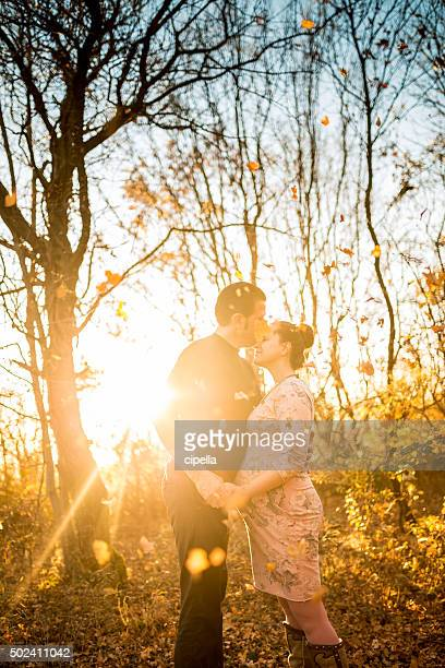 Pregnant couple in love outdoors