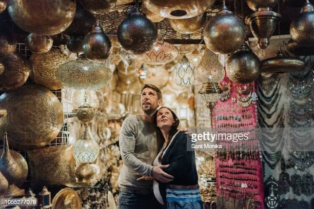 pregnant couple in souk, marrakech, morocco - moroccan culture stock photos and pictures