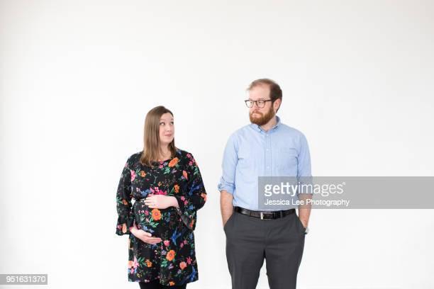 Pregnant couple, white background