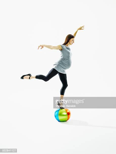 Pregnant dancer balancing on small circus ball