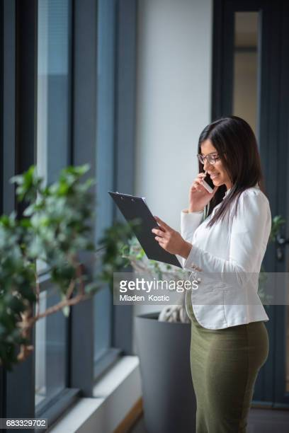 Pregnant employee working in office