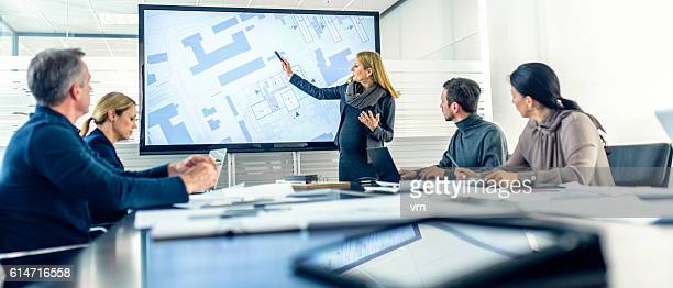 pregnant female architect having a presentation - council flat stock pictures, royalty-free photos & images