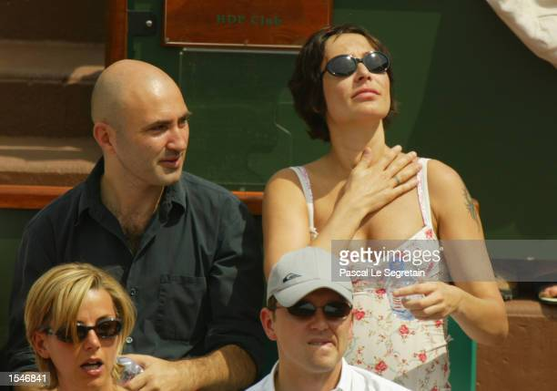 Pregnant French singer Zazie and an unidentified companion attend a match at the French Tennis Open at the village of Roland Garros June 1 2002 in...