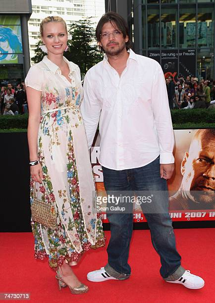Pregnant German model Franziska Knuppe and her husband Christian Moestl attend the German premiere to Die Hard 40 at the Sony Center CineStar on June...