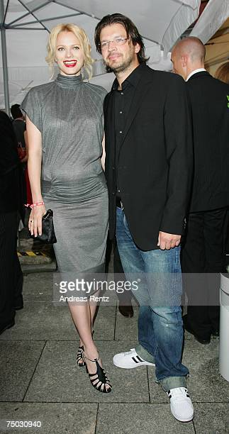 Pregnant German model Franziska Knuppe and her husband Christian Moestl attend the BILD and BAMS summer reception on July 4 2007 in Berlin Germany