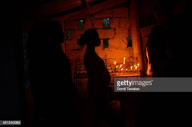 Pregnant girl attends a religious mass in a local chapel following the recent super typhoon on November 22, 2013 in Santa Rita township, Eastern...