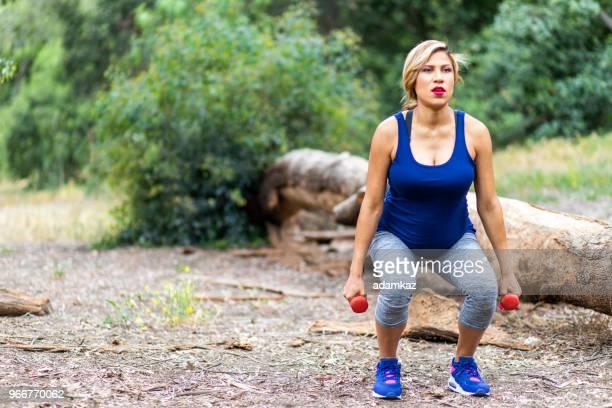 Pregnant Hispanic Woman Squats