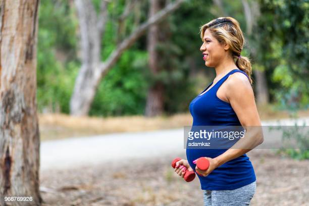 Pregnant Hispanic Woman Working Out