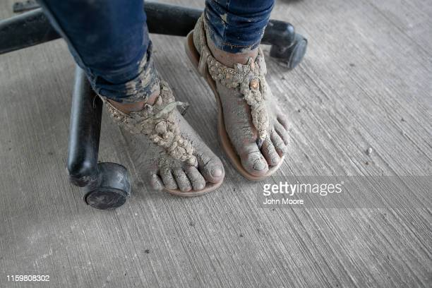 A pregnant immigrant from Guatemala waits to be interviewed by US Border Patrol agents after she crossed the Rio Grande from Mexico on July 02 2019...