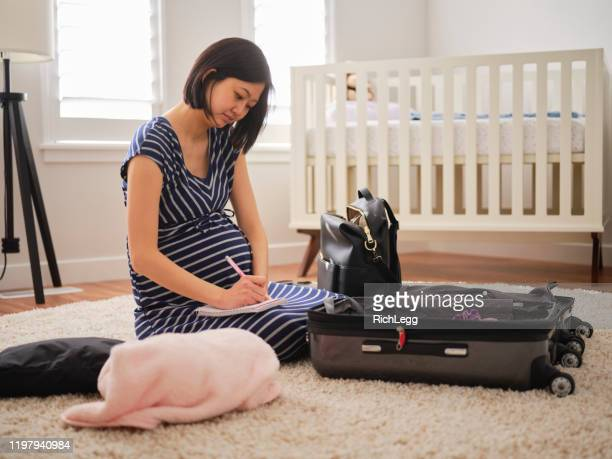 pregnant japanese woman in a nursery - diaper bag stock pictures, royalty-free photos & images