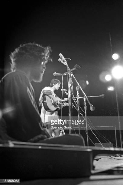 Pregnant Joan Baez sings at Harvard Stadium, Brighton, Boston, Massachusetts, 1969.