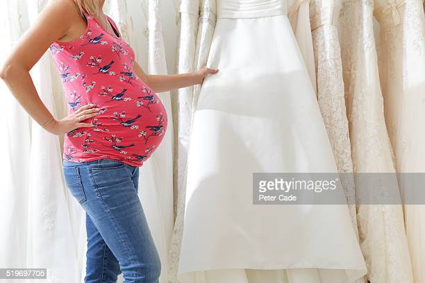 Pregnant lady looking at wedding dresses