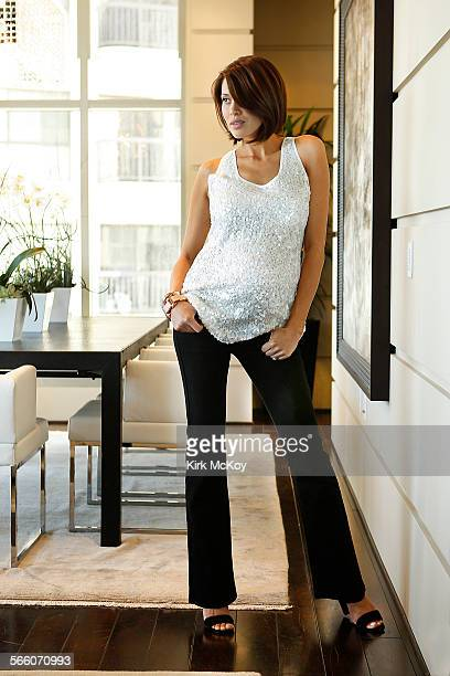 Pregnant model Rochelle Brodin wears James jeans, Lavish by Heidi Klum sequin top, Rosegold shoes,Alexis Bittar bangles and earrings at the Carlyle...
