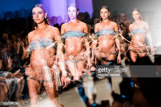 A pregnant model walks the runway during the Agua de Coco show during Sao Paulo Fashion Week N46 SPFW Winter 2019 at ARCA on October 26 2018 in Sao...