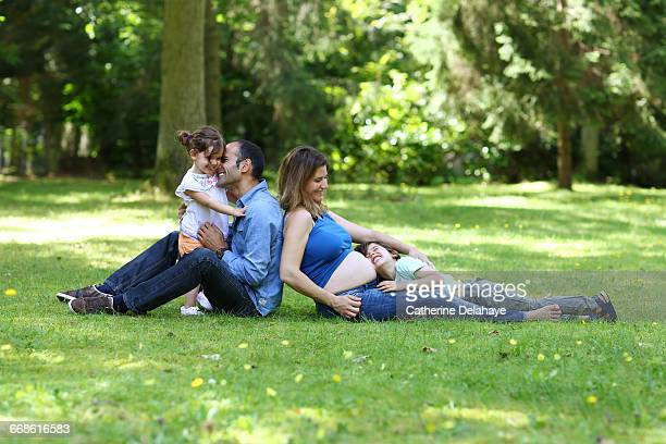 A pregnant mom and her family in the garden