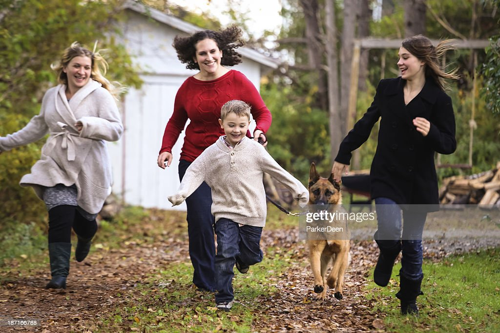 Pregnant Mom, Friends, Little Boy, Dog Playing Running in Autumn : Stock Photo