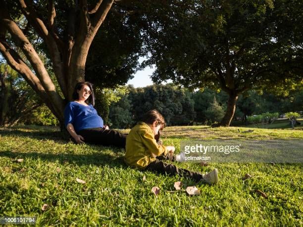 Pregnant Mother And 5 Years Old Son In Public Park