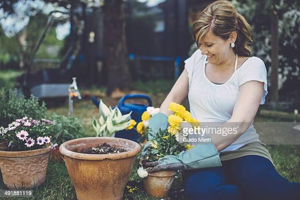 Pregnant mother gardening.