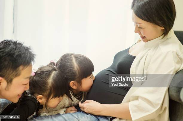 Pregnant mother with her family in home