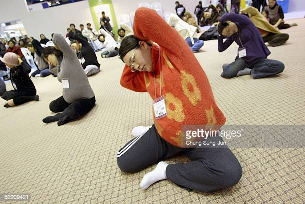 Pregnant mothers participate in an exercise class at a Pregnancy and Maternity exhibition Babyfair 2005 on February 17 2005 in Seoul South Korea...