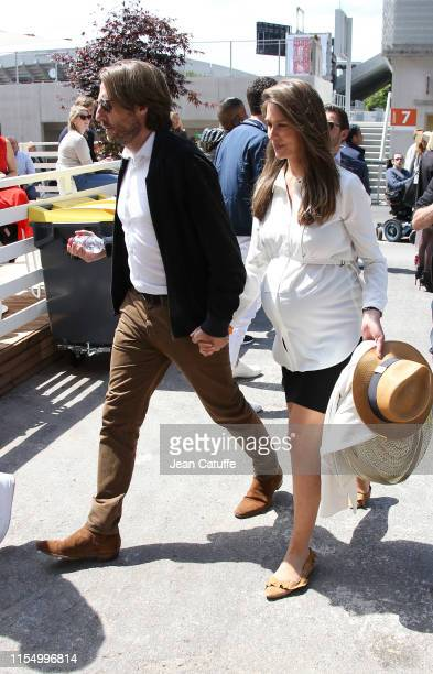 Pregnant Ophelie Meunier and husband Mathieu Vergne attend the men's final during day 15 of the 2019 French Open at Roland Garros stadium on June 9...