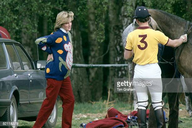 Pregnant Princess Diana Rubbing Her Back While Chatting With Prince Charles At Polo, Windsor. She Is Wearing A Jumper With A Koala Bear Design On The...